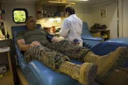 Marines and Sailors donate blood for the Armed Services Blood Program (ASBP)